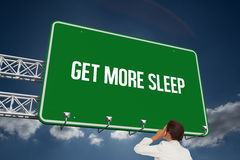 Get more sleep against sky. The word get more sleep and thinking businesswoman against sky Stock Photography