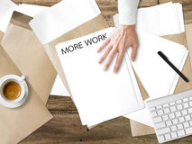 Get more work. Getting more paperwork task on desk Royalty Free Stock Photography