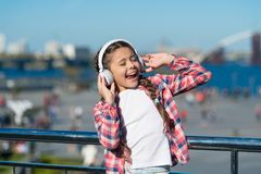 Get music family subscription. Access to millions of songs. Enjoy music everywhere. Best music apps that deserve a. Listen. Girl child listen music outdoors stock image