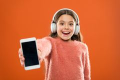 Get music family subscription. Access to millions of songs. Enjoy music concept. Best music apps that deserve a listen. Girl child listen music modern royalty free stock photo