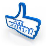 Get Noticed Thumbs Up Awareness Marketing Attention. Get Noticed words on a 3d thumbs up symbol to illustrate raising awareness and gaining attention through Royalty Free Stock Photos
