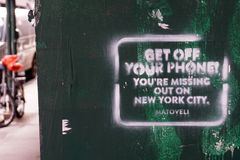`Get Off Your Phone! You`re Missing Out on New York City. Matoveli` Sign Royalty Free Stock Images