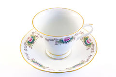 Get out the china for tea. Flora patterned porcelain cup and saucer Stock Photos