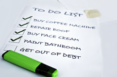 Get out of debt need. To do list with get out of debt unchecked Stock Photos