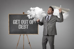 Get out of debt text on blackboard with businessman Royalty Free Stock Images