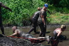 Get out of the mud. A group struggles in the muddy water at the 2012 mudathlon in Indiana Stock Photo