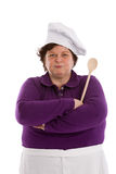 Get out of my cooky jar!. Female chef looking very stern with arms crossed Royalty Free Stock Photography