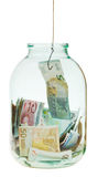 Get out saving euro money from glass jar Royalty Free Stock Image
