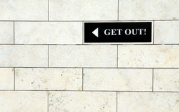 Get out sign. Black get out sign on the white wall Stock Photos