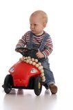 Get out of the way. Toddler-boy sitting on his toy-car royalty free stock images