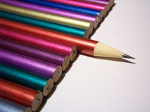 Get the point?. A row of colorful pencils on white background stock photo