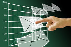 Get the profit from stock exchange. Hand push the mail of profit from the grow up stock exchange Royalty Free Stock Photo