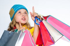 Get promo code. Shopping on black friday. Girl amazed face knitted hat hold shopping bags white background. Amazing. Shopping concept. Buy clothes amazing royalty free stock images
