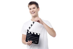 Get ready for the action !. Cheerful young male with open film slate Royalty Free Stock Photos