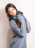 Get ready for the cold. Get ready for the cold, brunette girl in large blue sweater Stock Images
