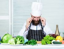 Get ready. Man bearded chef getting ready cooking delicious dish. Chef at work starting shift. Guy in professional stock images