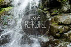 Get refreshed. Shot of beautiful waterfall with text on it stock photography