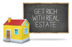 Get rich with real estate on blackboard. Get rich with real estate text on blackboard with 3d house front of blackboard on white background Royalty Free Stock Images