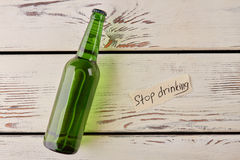 Get rid of alcoholism how to. Stop drinking message, glass bottle of alcohol Stock Photography