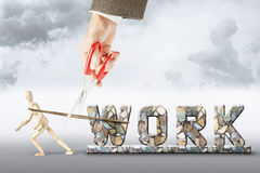 Get rid from hard work. Abstract image with a wooden puppet Stock Images