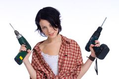 Get the right drill. Young do-it-yourselfer with a drilling machine Stock Photography