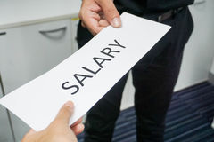 Get a salary from the boss. Concept to get a salary from the boss Royalty Free Stock Image