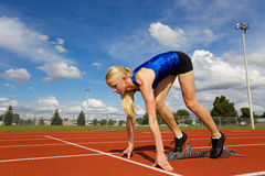 Get set. Young athlete on the starting blocks ready to race Royalty Free Stock Photos
