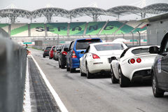 Get set, ready, go. Anonymous cars queued up at the pit lane exit at Sepang International Circuit  during the high performance challenge track day on May 2010 Stock Image
