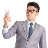 Get shocked while reading on smart phone. Royalty Free Stock Photos