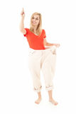 Get slim young woman pointing up Stock Image