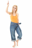 Get slim young woman pointing up Royalty Free Stock Image