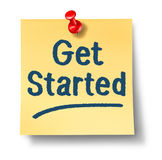 Get Started Office Note. On yellow paper and a red thumb tack as a concept of a new start and encouragement to begin a journey on a white background royalty free illustration