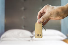 Get a suite in the luxe hotel. Guest holding the hotel room key at the hotel suite Royalty Free Stock Image