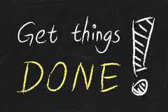 Get Things Done. Text is written by chalk on blackboard Stock Photography