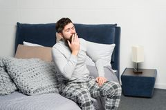 Get up early. Tips for waking up early. Man bearded hipster sleepy face waking up bedroom interior. Schedule for healthy. Lifestyle. Sweet yawn. Rest and relax royalty free stock photography