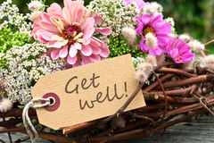 Get well. Pink flowers and card with lettering get well Royalty Free Stock Photos