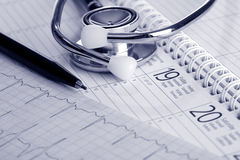 Get well soon. A stethoscope on a heart rate printout Royalty Free Stock Images
