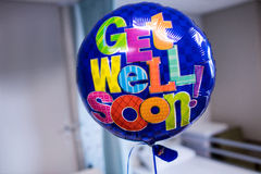 Get well soon balloon in hospital. Close-up of get well soon balloon in hospital stock photography