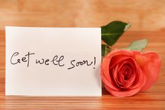 Get well soon. Beautiful shot of get well soon message on white paper royalty free stock photo