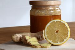 Get well soon or better stay healthy right away. Honey ginger and lemon as means to prevent an upcoming cold and to keep resilience high and strenghten the body royalty free stock photo