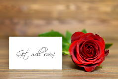 Get well soon. Card and red rose stock images