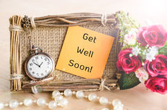Get Well Soon greeting card. Hand-made Get Well Soon greeting card with roses and pocket watch royalty free stock photo