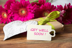 Get well soon. Nice decoration with card and pink flowers stock images
