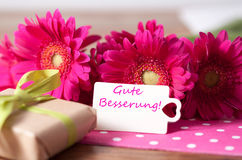 Get well soon. Pink flowers and card with lettering get well soon royalty free stock images