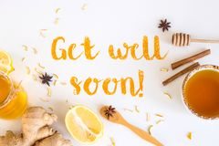 Get well soon - postcard with text. Get well soon - written from ground turmeric on a white background among the products for the treatment of common cold royalty free stock photography
