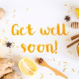 Get well soon - postcard with text. Get well soon - written from ground turmeric on a white background among the products for the treatment of common cold royalty free stock image