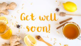 Get well soon - postcard with text. Get well soon - written from ground turmeric on a white background among the products for the treatment of common cold stock photography
