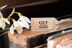 Get well soon. Snowdrop and card with lettering get well soon royalty free stock photography