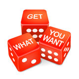 Get what you want words on three red dice Stock Photo