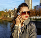 Young trendy woman speaking on cell phone near Eiffel tower Stock Photos